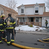North Metro Fire Rescue District firefighters stand by after extinguishing the fire at  308 Mulberry Circle on Saturday. No reports of injuries and the cause of the fire is under investigation.<br /> <br /> March 6, 2010<br /> Staff photo/David R. Jennings