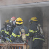 Firefighters from North Metro Fire Rescue District prepare to enter 308 Mulberry Circle which caught on fire Saturday. No reports of injuries and the cause of the fire is under investigation.<br /> <br /> March 6, 2010<br /> Staff photo/David R. Jennings