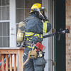 A North Metro Fire Rescue District firefighter prepare to enter 308 Mulberry Circle which caught on fire Saturday. No reports of injuries and the cause of the fire is under investigation.<br /> <br /> March 6, 2010<br /> Staff photo/David R. Jennings