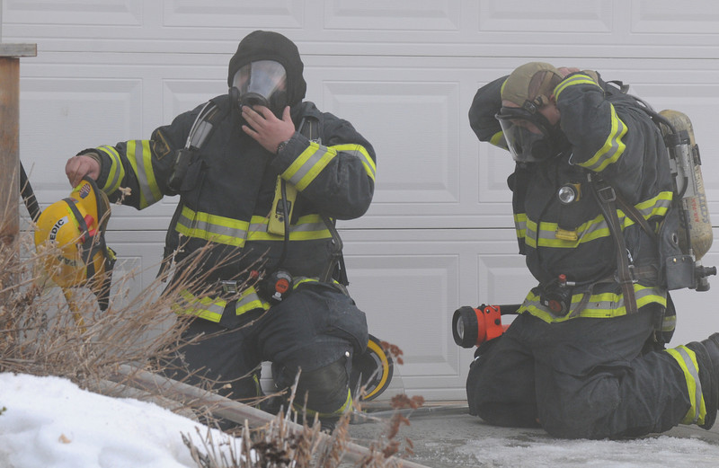 North Metro Fire Rescue District firefighters prepare to enter 308 Mulberry Circle which caught on fire Saturday. No reports of injuries and the cause of the fire is under investigation.<br /> <br /> March 6, 2010<br /> Staff photo/David R. Jennings