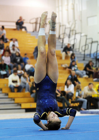Cassie Preskitt, Legacy, performing her floor routine during the Eagle/Mustang invitational gymnatics meet at Mountain Range High School on Saturday.<br /> October 10, 2009<br /> Staff photo/David R. Jennings