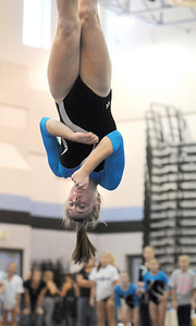 Melissa Moonie, Broomfield, goes upside down in her floor routine during the Eagle/Mustang invitational gymnatics meet at Mountain Range High School on Saturday. October 10, 2009 Staff photo/David R. Jennings