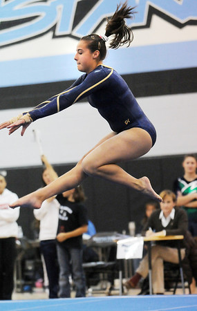 Maddie Rivas, Legacy, performing her floor routine during the Eagle/Mustang invitational gymnatics meet at Mountain Range High School on Saturday.<br /> October 10, 2009<br /> Staff photo/David R. Jennings