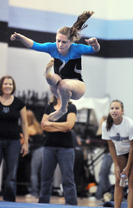 Melissa Moonie, Broomfield, performing her floor routine during the Eagle/Mustang invitational gymnatics meet at Mountain Range High School on Saturday. October 10, 2009 Staff photo/David R. Jennings