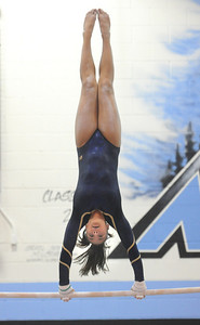 Maddie Rivas, Legacy, on the uneven bars during the Eagle/Mustang invitational gymnatics meet at Mountain Range High School on Saturday. October 10, 2009 Staff photo/David R. Jennings
