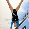 JoJo Hayden, Broomfield, performs on the uneven bars during the Eagle/Mustang invitational gymnatics meet at Mountain Range High School on Saturday.<br /> October 10, 2009<br /> Staff photo/David R. Jennings