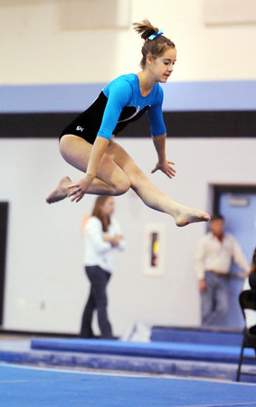 JoJo Hayden, Broomfield, performing her floor routine during the Eagle/Mustang invitational gymnatics meet at Mountain Range High School on Saturday.<br /> October 10, 2009<br /> Staff photo/David R. Jennings