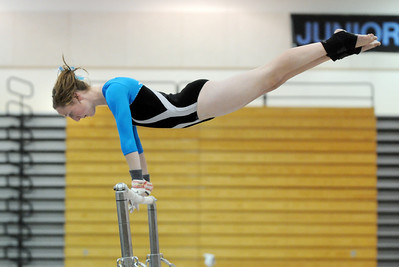 Kate Knights, Broomfield, prforms her routine on the uneven bars during the Eagle/Mustang invitational gymnatics meet at Mountain Range High School on Saturday. October 10, 2009 Staff photo/David R. Jennings