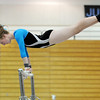 Kate Knights, Broomfield, prforms her routine on the uneven bars during the Eagle/Mustang invitational gymnatics meet at Mountain Range High School on Saturday.<br /> October 10, 2009<br /> Staff photo/David R. Jennings
