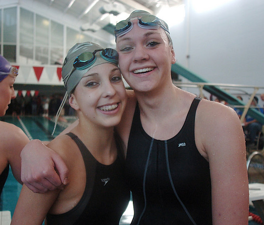Broomfield swimmers Abi Young left, and Lexie Roach smile afte swimming in the 200 yrd freestyle during the Boulder County Invitational swim meet at the South Boulder Recreation Center on Saturday.<br /> <br /> <br /> January 23, 2010<br /> Staff photo/David R. Jennings