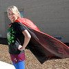 "Amanda Rogers, complete with a cape, dressed as ""Superwoman"" for super hero day during homecoming week at Broomfied High School on Wednesday.<br /> <br /> Sept. 30, 2009<br /> Staff photo/David R. Jennings"