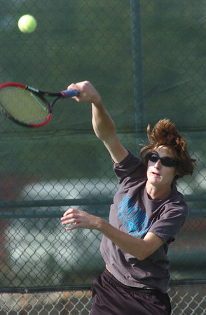 Andrew Flora, Broomfield High returns the ball during the #1 singles match against Cherry Creek at the Broomfield Swim and Tennis Club on Wednesday.<br /> Sept. 16, 2009<br /> Staff photo/David R. Jennings