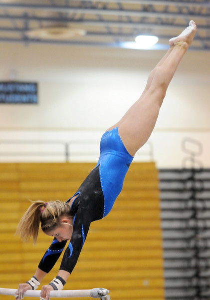 Amy Baum performs her routine on the bars during 29th annual Broomfield Invitational gymnastics meet at Mountain Range High on Saturday.<br /> <br /> October 2, 2010<br /> staff photo/David R. Jennings