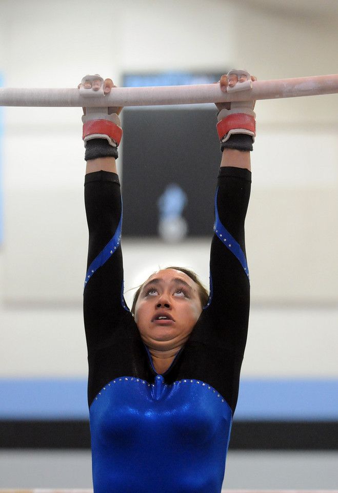 Gabby Maiden swings on the bars while competing during 29th annual Broomfield Invitational gymnastics meet at Mountain Range High on Saturday.<br /> <br /> October 2, 2010<br /> staff photo/David R. Jennings