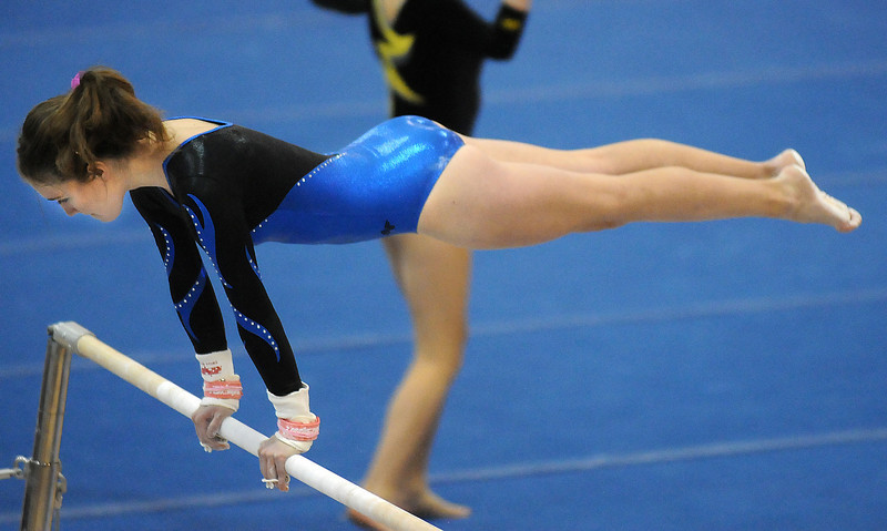 Melanie Steling competes on the bars during 29th annual Broomfield Invitational gymnastics meet at Mountain Range High on Saturday.<br /> <br /> October 2, 2010<br /> staff photo/David R. Jennings