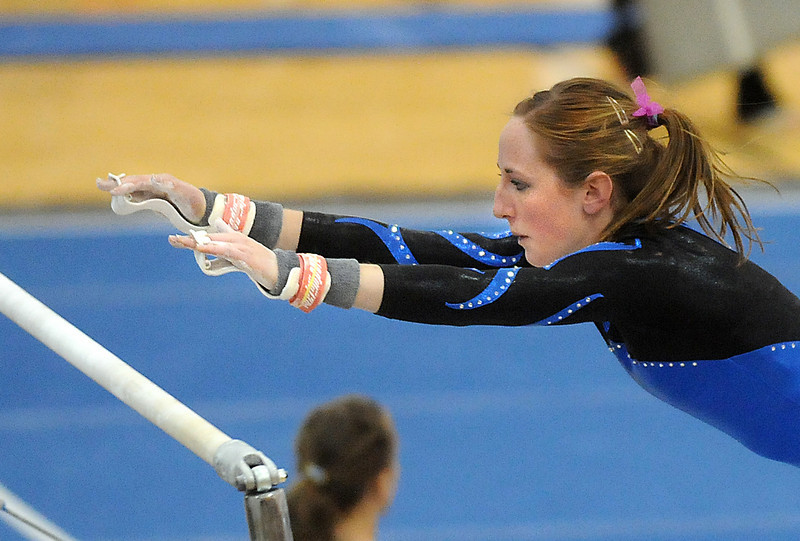 Kate Knights performs on the bars during 29th annual Broomfield Invitational gymnastics meet at Mountain Range High on Saturday.<br /> <br /> October 2, 2010<br /> staff photo/David R. Jennings