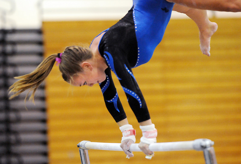 Allie Burgess concentrates while preforming on the bars during 29th annual Broomfield Invitational gymnastics meet at Mountain Range High on Saturday.<br /> <br /> October 2, 2010<br /> staff photo/David R. Jennings