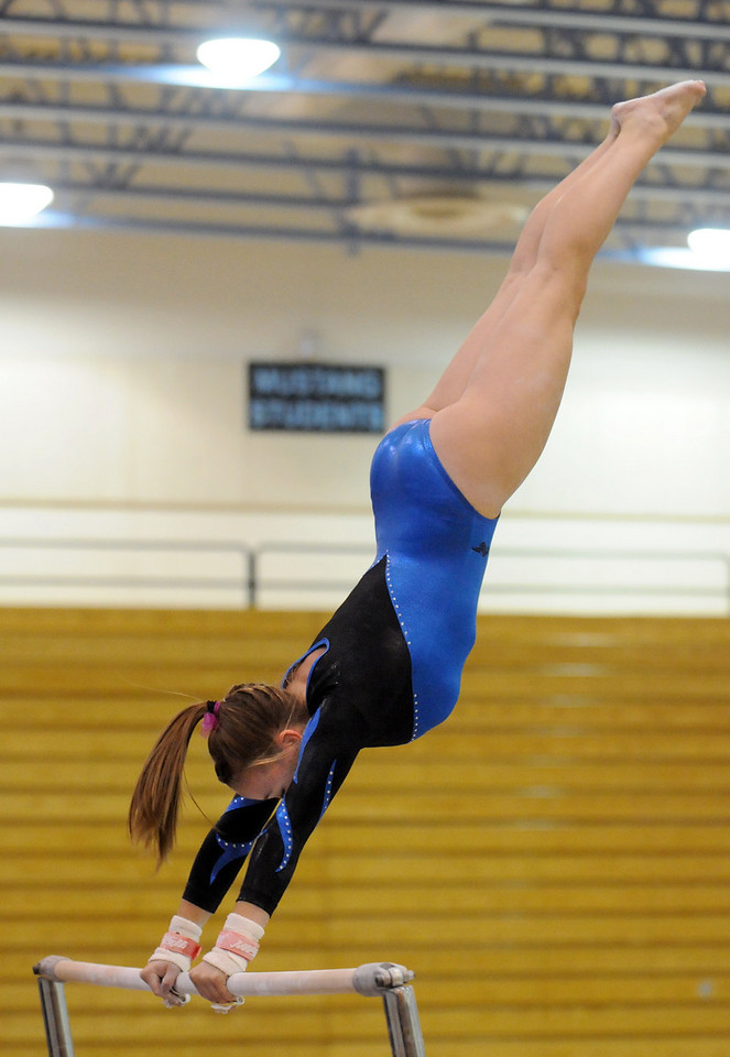 Allie Burgess performs on the bars during 29th annual Broomfield Invitational gymnastics meet at Mountain Range High on Saturday.<br /> <br /> October 2, 2010<br /> staff photo/David R. Jennings
