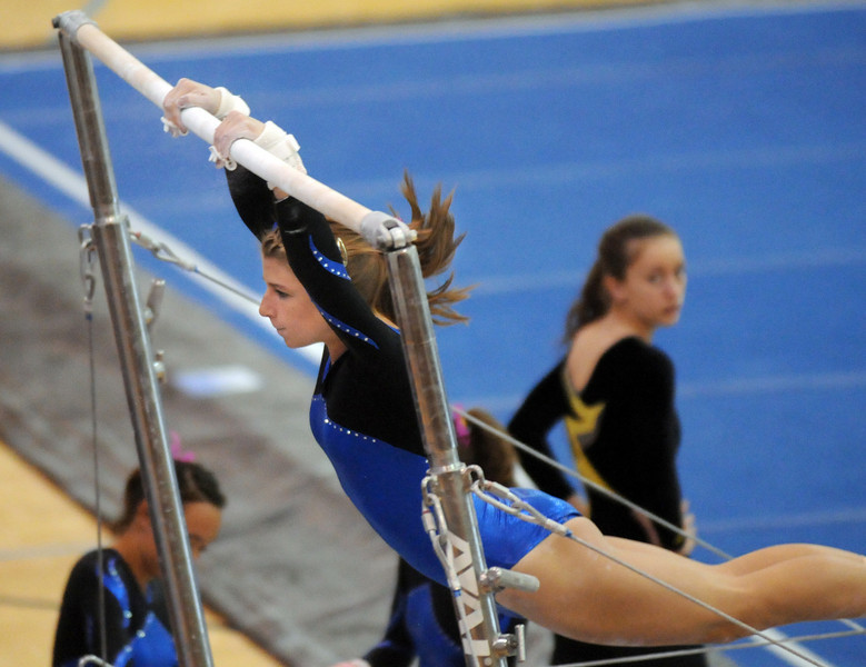 Kesly Dilz performs on the bars during 29th annual Broomfield Invitational gymnastics meet at Mountain Range High on Saturday.<br /> <br /> October 2, 2010<br /> staff photo/David R. Jennings