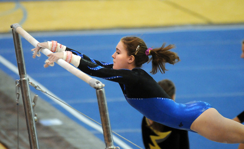 Kelsy Dilz perform a routine on the bars during 29th annual Broomfield Invitational gymnastics meet at Mountain Range High on Saturday.<br /> <br /> October 2, 2010<br /> staff photo/David R. Jennings
