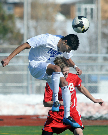Carlos Mendez, Broomfield does a header away from Todd Bushman, Castle View, during Saturday's game at Elizabeth Kennedy Stadium.<br /> October 31, 2009<br /> Staff photo/David R. Jennings