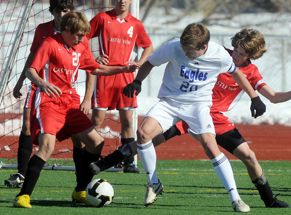 Garrett Seitz, Broomfield fights for control of the ball with Castle View's Jordan Kedzierski, left, and Todd Bushman during Saturday's game at Elizabeth Kennedy Stadium.<br /> October 31, 2009<br /> Staff photo/David R. Jennings
