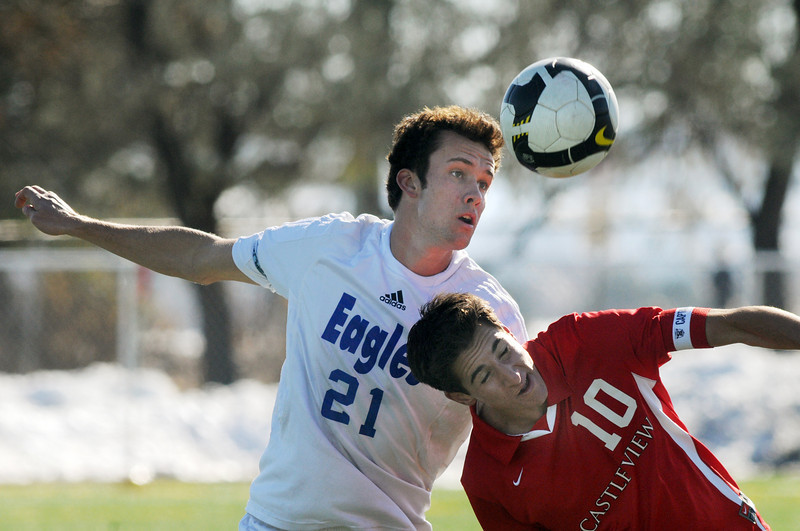 Cole Chapleski, Broomfield, doews a header over Kory Davis, Castle View during Saturday's game at Elizabeth Kennedy Stadium.<br /> October 31, 2009<br /> Staff photo/David R. Jennings