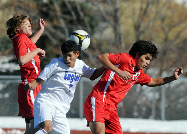 Carlos Mendez, Broomfield, collides with Castle View's Todd Bushman, left and Hector Porragas during Saturday's game at Elizabeth Kennedy Stadium.<br /> October 31, 2009<br /> Staff photo/David R. Jennings
