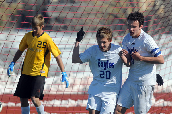 Broomfield's Garrett Seitz, center, celebrates his goal with Cole Chapleski with Castle View's goalie Sam Peterson in the goalduring Saturday's game at Elizabeth Kennedy Stadium.<br /> October 31, 2009<br /> Staff photo/David R. Jennings