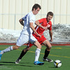 Cole Chapleski, Broomfield keeps the ball away from Zach Siegert, Castle View, during Saturday's game at Elizabeth Kennedy Stadium.<br /> October 31, 2009<br /> Staff photo/David R. Jennings