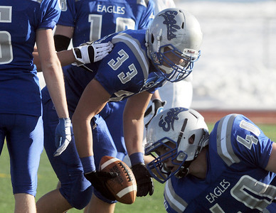 Dominic Niemi, Broomfield, recovers a loose ball from Greeley Central, during Saturday's game at Elizabeth Kennedy Stadium.  October 31, 2009 Staff photo/David R. Jennings