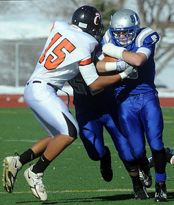 Dan Guebelle, right, Broomfield, is stopped by Jesse Freeman, Greeley Central, during Saturday's game at Elizabeth Kennedy Stadium.  October 31, 2009 Staff photo/David R. Jennings