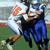Dan Guebelle, right, Broomfield, is stopped by Jesse Freeman, Greeley Central, during Saturday's game at Elizabeth Kennedy Stadium. <br /> October 31, 2009<br /> Staff photo/David R. Jennings