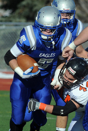 Dan Guebelle, Broomfield, carries the ball as Cody Sandau, Greeley Central, attempts a tackle during Saturday's game at Elizabeth Kennedy Stadium.<br /> October 31, 2009<br /> Staff photo/David R. Jennings