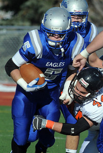 Dan Guebelle, Broomfield, carries the ball as Cody Sandau, Greeley Central, attempts a tackle during Saturday's game at Elizabeth Kennedy Stadium. October 31, 2009 Staff photo/David R. Jennings