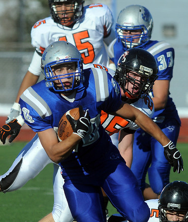 Broomfield's Sean Gentry carries the ball downfield away from Kole Kadavy, Greeley Central, during Saturday's game at Elizabeth Kennedy Stadium.<br /> October 31, 2009<br /> Staff photo/David R. Jennings