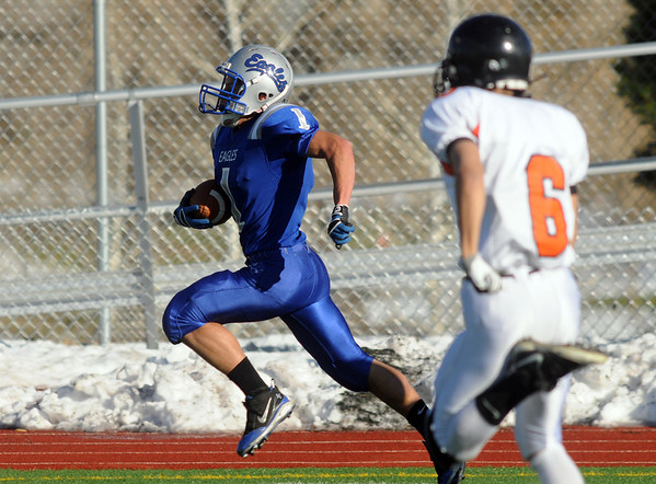 Trent Ireland, Broomfield, runs for a touchdown away from Andrew Trevino, Greeley Central, during Saturday's game at Elizabeth Kennedy Stadium.<br /> October 31, 2009<br /> Staff photo/David R. Jennings