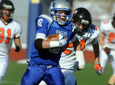 Dan Guebelle, Broomfield, runs downfield from Lane Ververs  and Cyrus Mora, Greeley Central, for a touchdown during Saturday's game at Elizabeth Kennedy Stadium. October 31, 2009 Staff photo/David R. Jennings