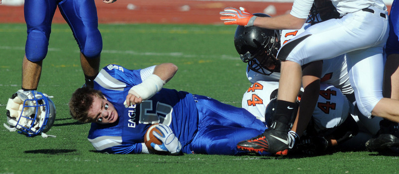 Dan Guebelle, Broomfield, looses his helmet after being tackled by Greeley Central players during Saturday's game at Elizabeth Kennedy Stadium. <br /> October 31, 2009<br /> Staff photo/David R. Jennings
