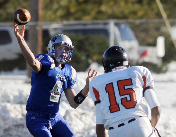 Quarterback Aric Kaiser, Broomfield, throws a pass before Jesse Freeman, Greeley Central, gets to him during Saturday's game at Elizabeth Kennedy Stadium. <br /> October 31, 2009<br /> Staff photo/David R. Jennings