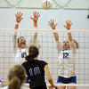 Broomfield's Jordan Sisson, left, and Brianna Fidder block the ball from Mountain View's Raquel Glakeler during Thursday's game at Broomfield.<br /> October 1, 2009<br /> staff photo/David Jennings