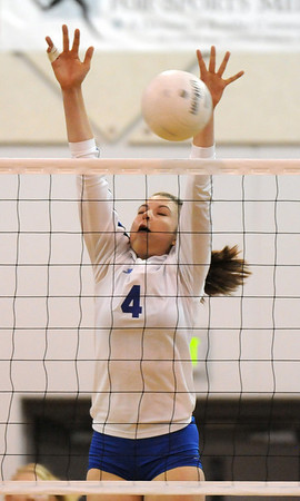 Broomfield's Kristen Leenerman blocks the ball from Mountain View during Thursday's game at Broomfield.<br /> October 1, 2009<br /> staff photo/David Jennings