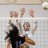 Lauren Knox, Broomfield, blocks the ball hit by Amy Medina, Mountain View during Thursday's game at Broomfield.<br /> October 1, 2009<br /> staff photo/David Jennings