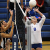 Broomfield's Kimmie Kreeger, right,  sets the ball for return to Mountain View during Thursday's game at Broomfield.<br /> October 1, 2009<br /> staff photo/David Jennings