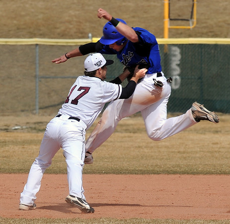 Broomfield Silver Creek Baseball79.JPG Dan Guebelle of Broomfield gets tagged out by Ryan Schram of Silver Creek on Saturday.<br /> Cliff Grassmick/ March 19, 2011
