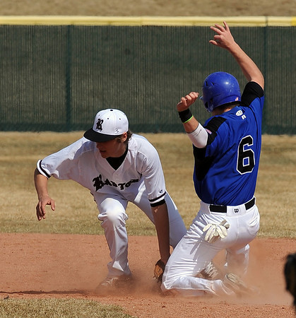 Broomfield Silver Creek Baseball30.JPG Andy McClaskey (6) of Broomfield, gets into second before the ball gets to Greg Reynolds of Silver Creek.<br /> Cliff Grassmick/ March 19, 2011