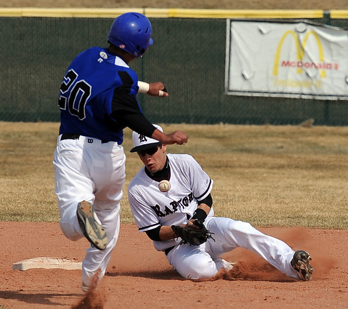 Broomfield Silver Creek Baseball59.JPG Ben Martinez of Broomfield gets to second safely as Marcus Stewart of Silver Creek bobbles the ball.<br /> Cliff Grassmick/ March 19, 2011