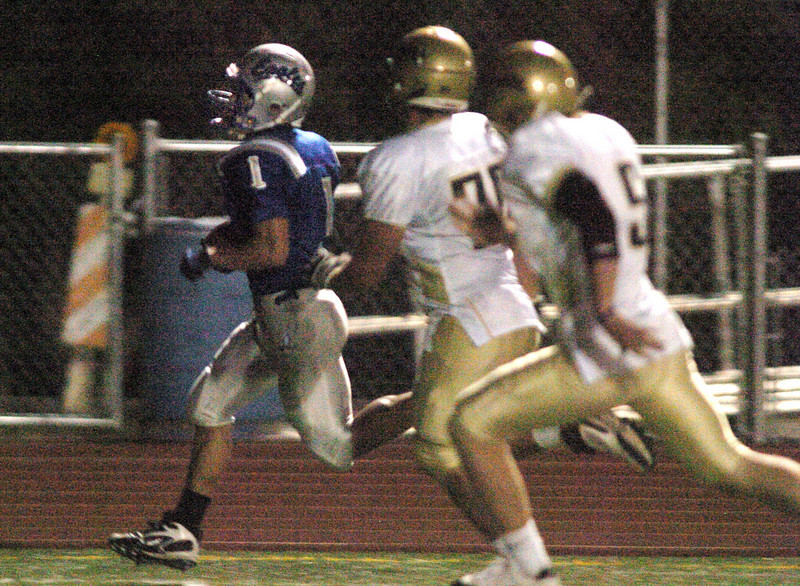 Broomfield's Trent Ireland runs for a touchdown after intercepting a pass by Greeley West during Friday's game at Elizabeth Kennedy Stadiium.<br /> <br /> October 1, 2010<br /> staff photo/David R. Jennings