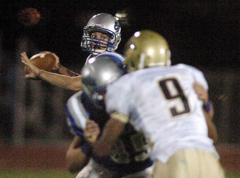 Broomfield's quarterback Aric Kaiser passes against Greeley West during Friday's game at Elizabeth Kennedy Stadiium.<br /> <br /> October 1, 2010<br /> staff photo/David R. Jennings