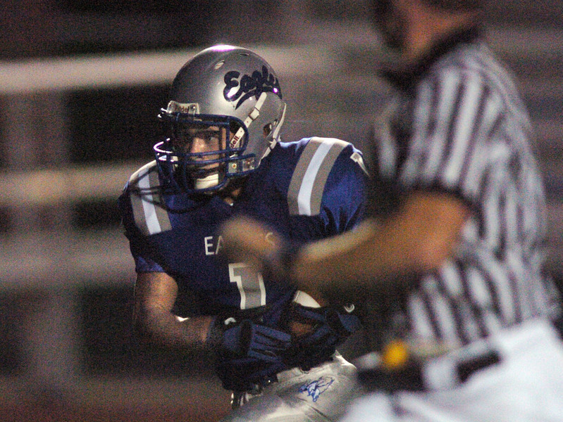 Broomfield's Trent Ireland runs downfield for a touchdown against Greeley West during Friday's game at Elizabeth Kennedy Stadiium.<br /> <br /> October 1, 2010<br /> staff photo/David R. Jennings